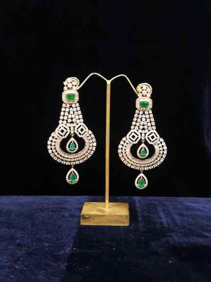 GOLD WITH DAIMOND WITH GREEN EARING