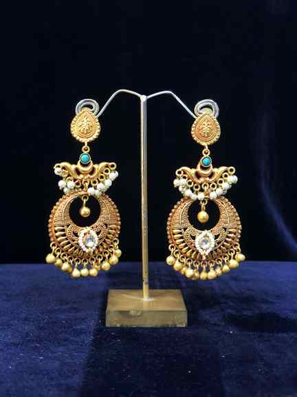 GOLD WITH EARING